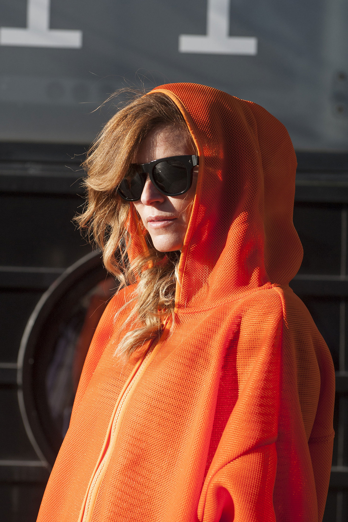 The style crowd can make anything a great accessory — sunglasses and even the hood of a jacket.