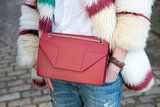 How do you turn up the cool factor on jeans and a white shirt? With a colored fur and bright bag, of course.