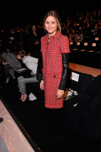 In a red tweed Carolina Herrera dress and Brian Atwood boots, Olivia was perfectly polished in Dennis Basso's front row.