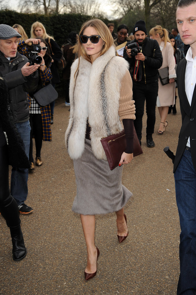 One word sums up Olivia's arrival at Burberry: posh. The front-row fixture piled on the texture and luxe and finished the whole outfit with a sleek zip clutch and Westward Leaning sunglasses.