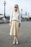 A chunky knit and a midi skirt in buttery shades look great against blonde hair.