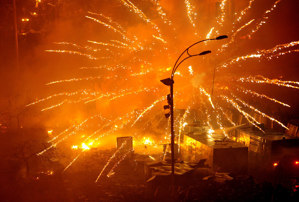 Fires burned as protesters clashed with police in Kiev.