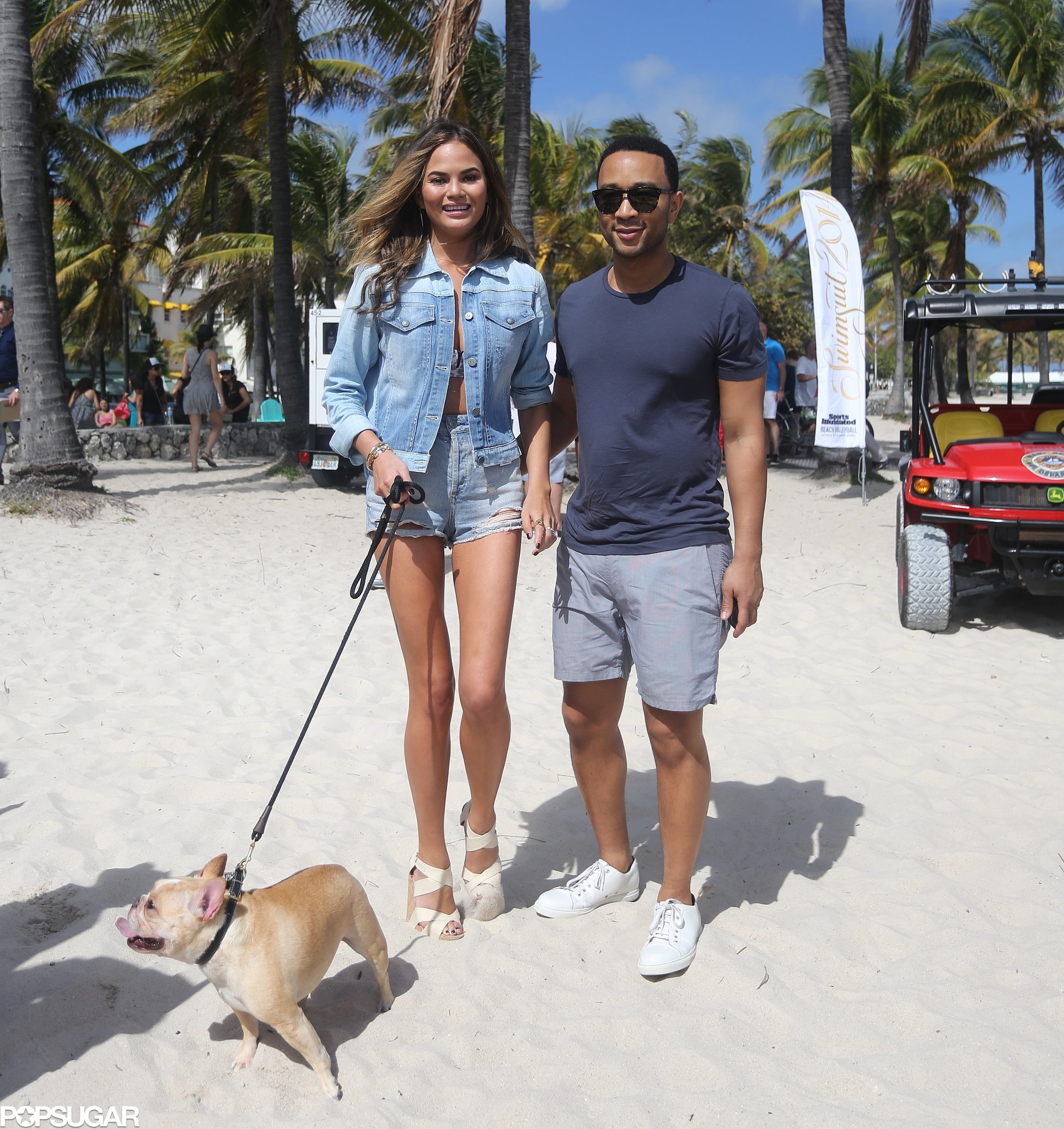Chrissy Teigen and John Legend took their dog for a walk on the beach ...