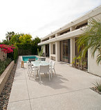 Cement and pebble landscaping enhances the home's modern allure and doesn't need to be watered. Photo by Tara Wujcik