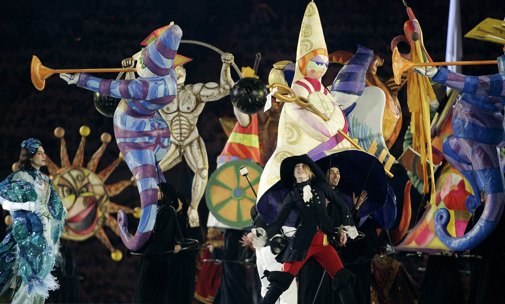 Actors wore elaborate, circus-style costumes.