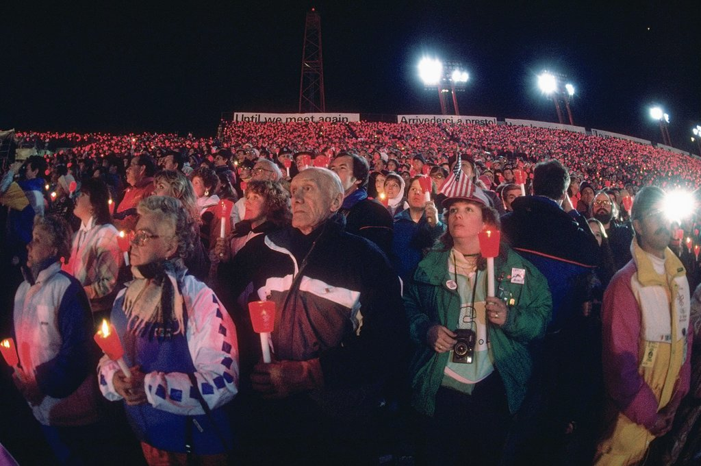 The stadium was filled with spectators holding up red candles.