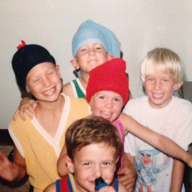 Smiling in the center, little January wore a cardigan vest and tights on her head.  Source: Instagram user januaryjones