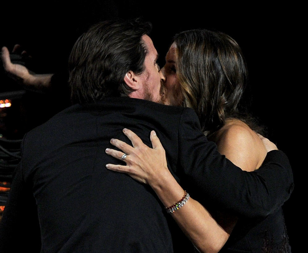 Christian gave Sibi a sweet kiss after winning the Oscar for best supporting actor in 2011.