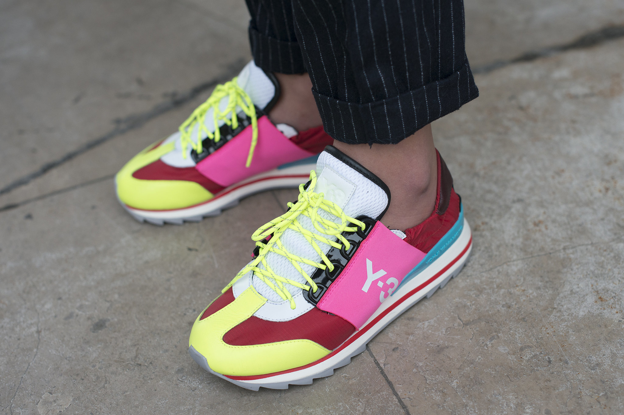 Rainbow-colored kicks up the cool factor on any outfit.