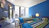 Two single beds occupy the blue room. Source: Capitas Real Estate