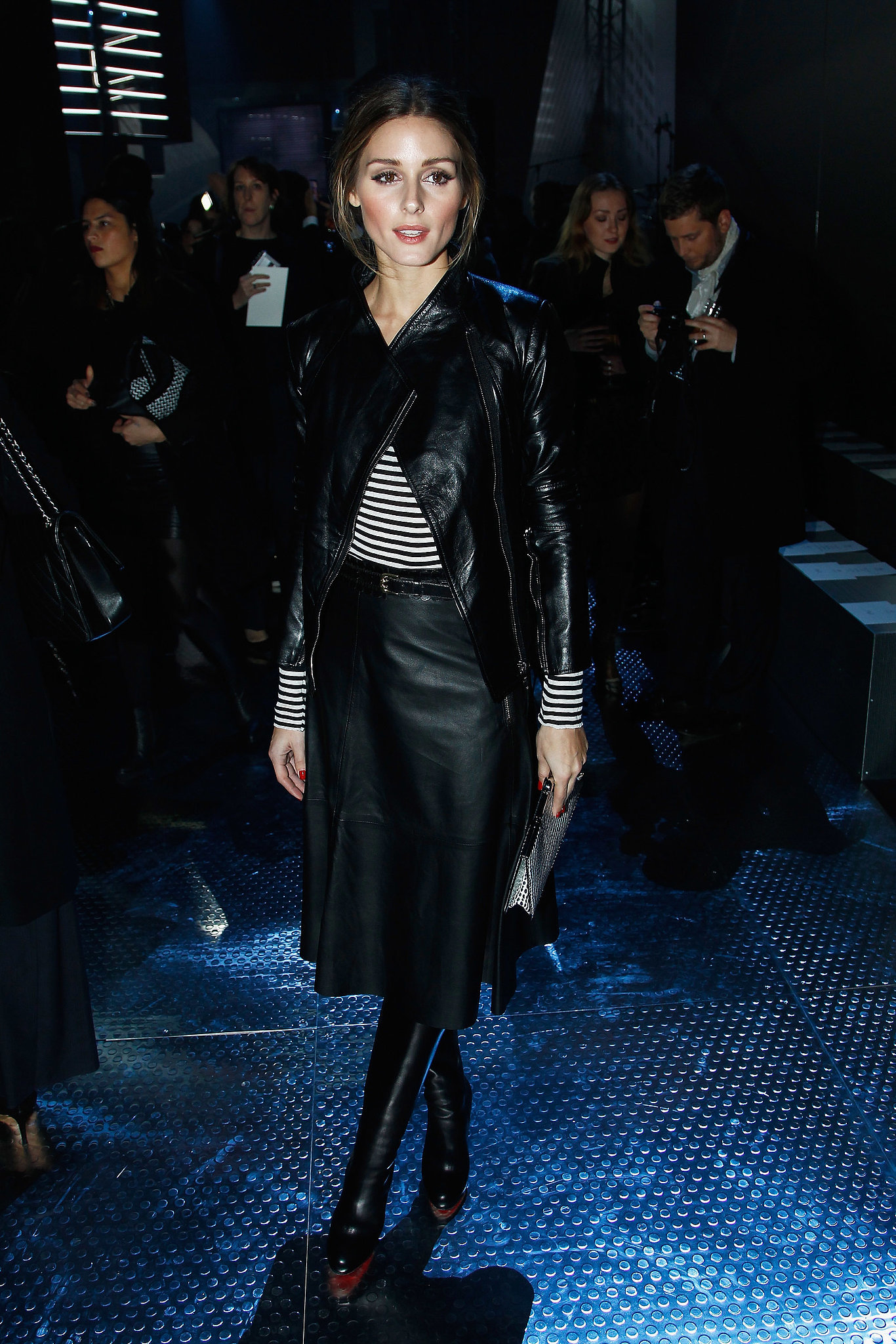 Olivia took the front row at H&M in classic stripes paired with sleek leather.