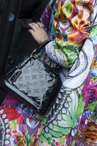 We love the high-shine black patent Louis Vuitton bag against the bold, high-impact print.