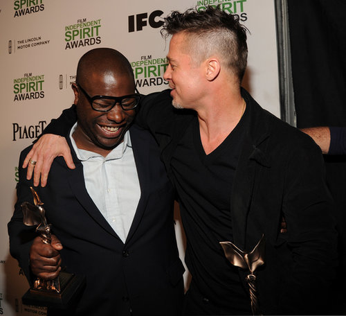 Brad Pitt wrapped his arm around director Steve McQueen after they both picked up Spirit Awards.