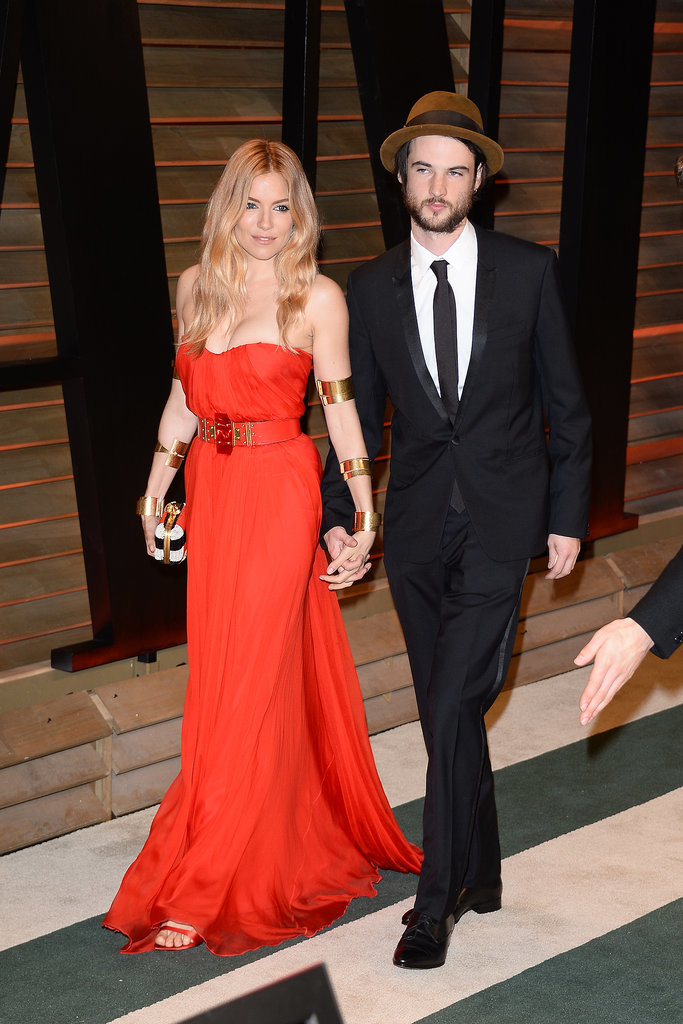 Sienna Miller walked the red carpet with her fiancé, Tom Sturridge.