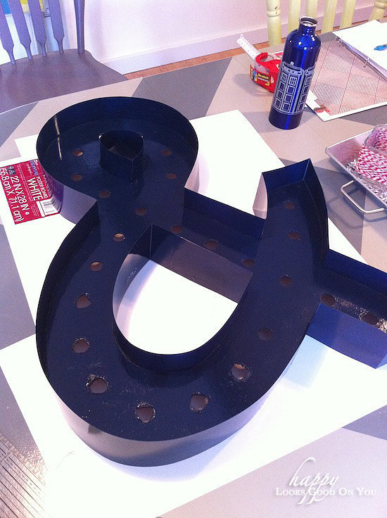 The ampersand received a few coats of glossy navy blue. And boy, does it look great! Source: Happy Looks Good on You