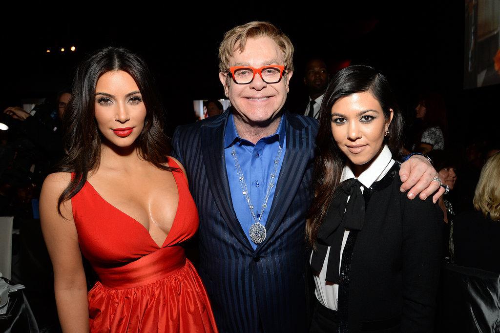 Kim and Kourtney mingled with Elton.