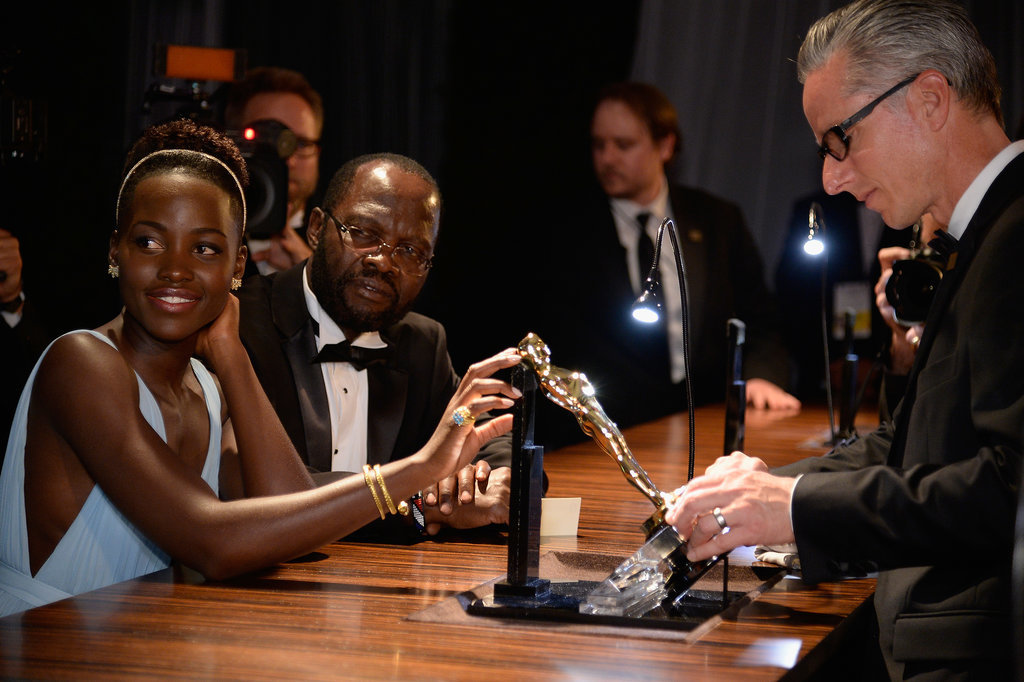 Lupita and her dad looked at her award.