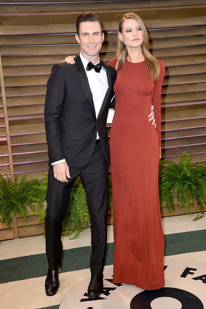Adam Levine and Behati Prinsloo brought their love to the Vanity Fair party.