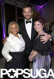 Bradley Cooper posed with his mom, Gloria Campano, and his sister Holly during the Vanity Fair Oscars afterparty.