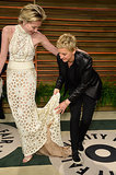 Ellen DeGeneres helped her wife, Portia de Rossi, out with her train while they posed outside the Vanity Fair bash.