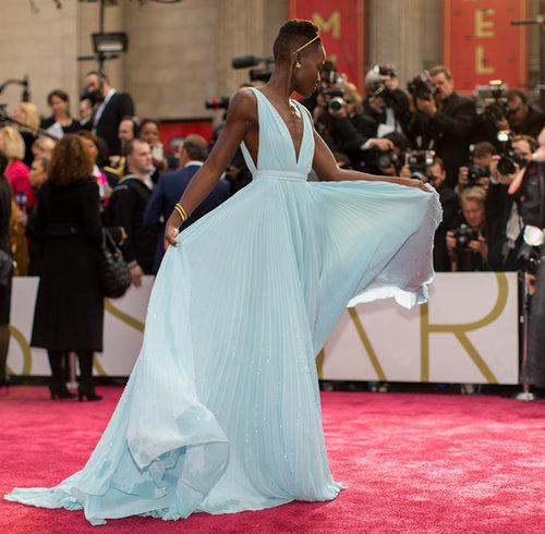 Lupita Nyong'o and her gorgeous blue Prada gown floated down the Oscars carpet.