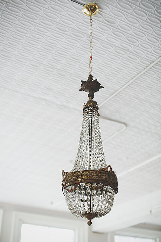 An antique chandelier adds a touch of old-world elegance.  Photo by Chellis Michael Photography