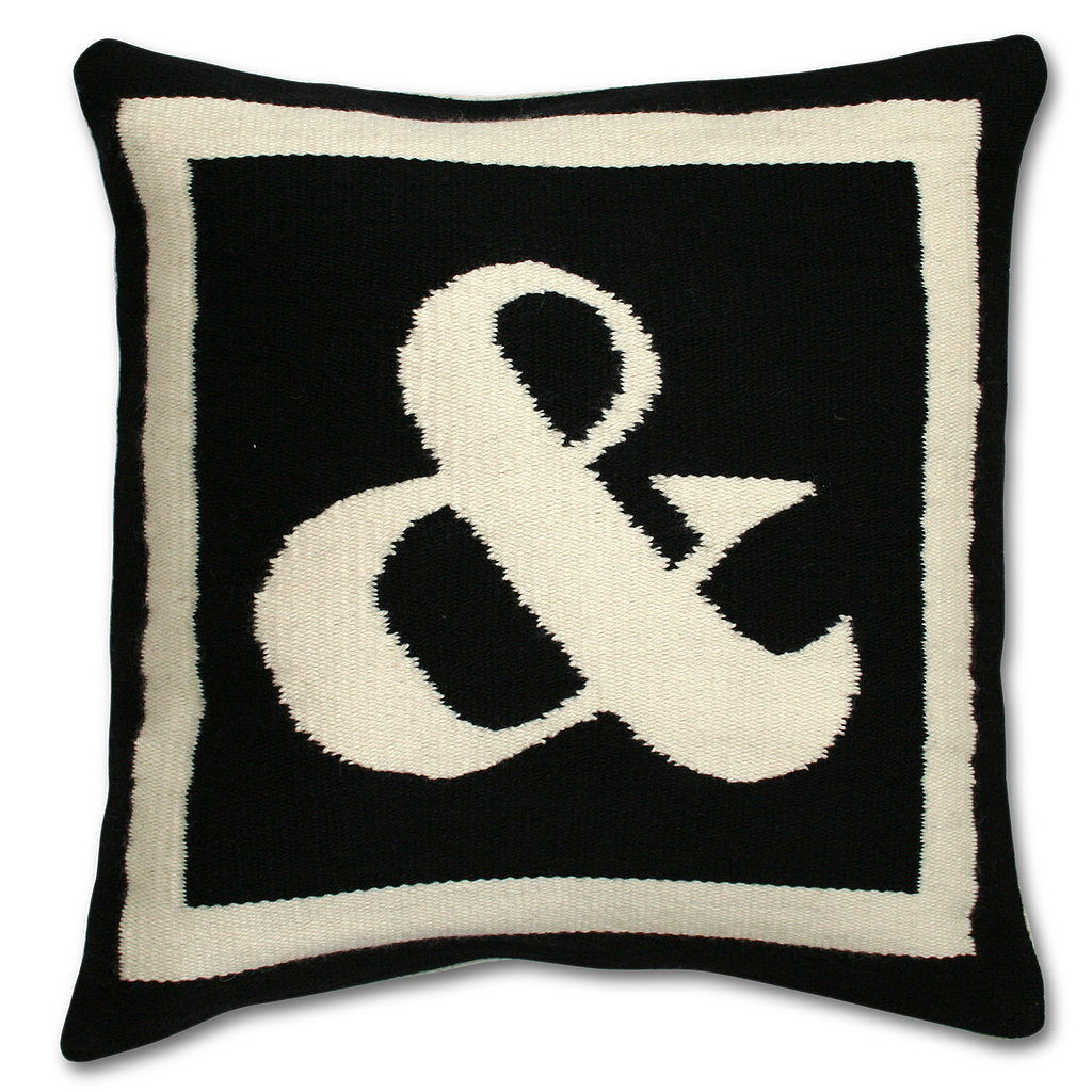 For a cheeky, subtle touch of typography, toss an ampersand pillow ($125) on your couch or bed. In simple black and white, it's sure to match any decor — and the style comes in all different letters and punctuation marks.