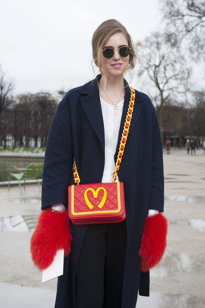 Chiara Ferragni toted the Moschino accessories straight off the Fall '14 runways.