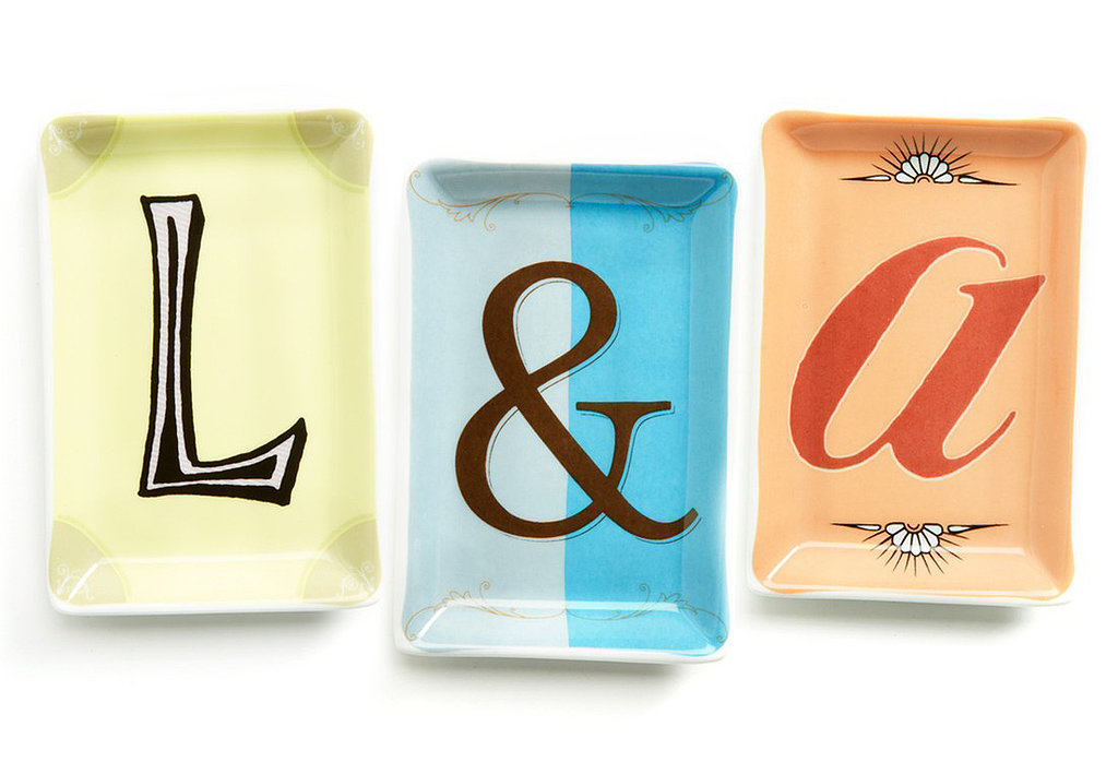 Collect more than one of these porcelain typography trays ($10 each) as a fun way to display jewelry.