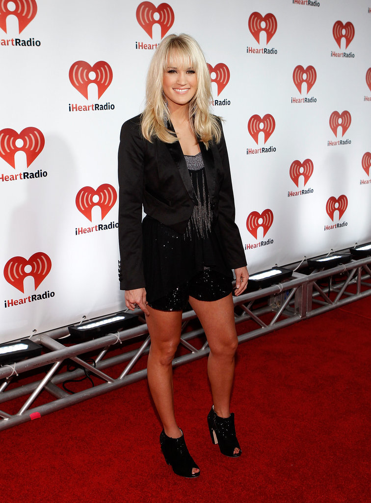 Carrie Underwood swapped her leggy minidresses for a decorated shorts suit — check out those sequined hot pants! — and rocker ankle boots in 2011.