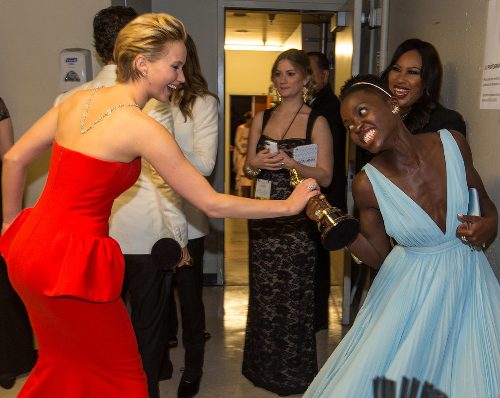 Jennifer Lawrence and Lupita Nyong'o — who were nominated together in the best supporting actress category at this year's Academy Awards — staged an adorable fight over the trophy.