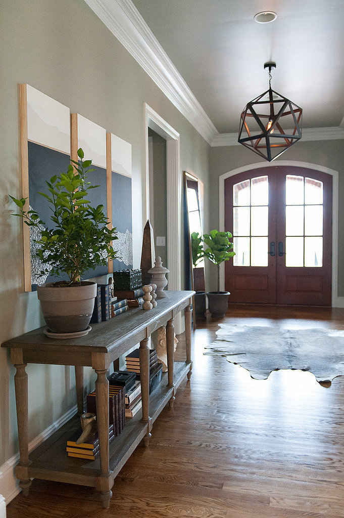 This soft, neutral green entryway allows for a warm and rustic welcome.  Photo by  Hannah Maple Studio via Style Me Pretty