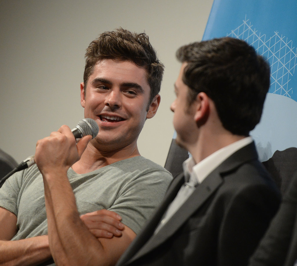 Zac Efron flashed his boyish grin at the Neighbors event on Saturday.