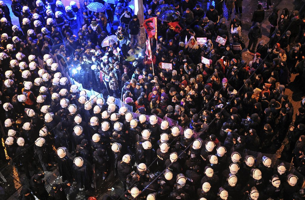 In Turkey, marching women met with a barricade of police officers.