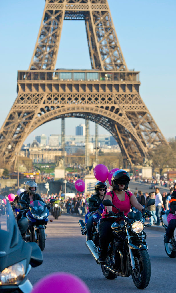 Female bikers made their way past the Eiffel Tower.