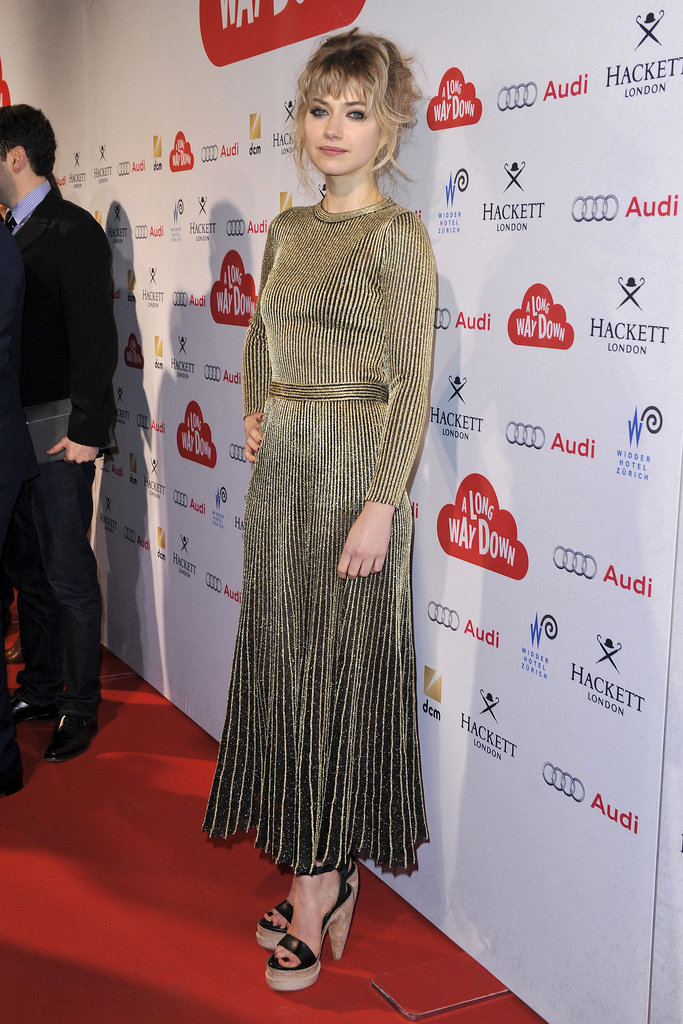 At the premiere of A Long Way Down in Zurich, Switzerland, Imogen shone in a gold dress with a pleated skirt.