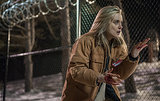 Piper (Taylor Schilling) looks at blood on her hands. Source: Netflix