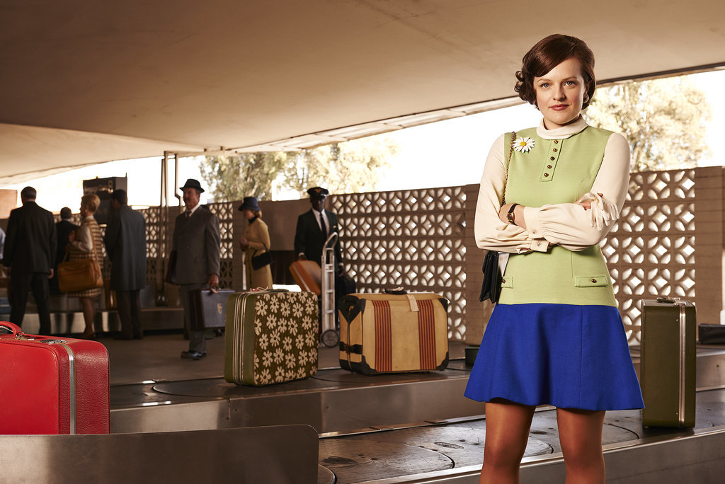 Peggy takes care of business by the baggage carousel.