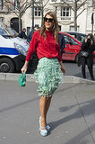 Anna Dello Russo raises the bar in a flirty mint green skirt.