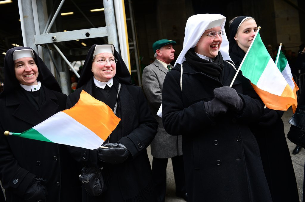 Nuns cheered and waved Irish flags during NYC's St. Patrick's Day parade.