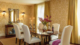 Damask wallpaper and matching mustard-hued drapes are a wink to the couple's traditional taste.    Source: Domaine Home