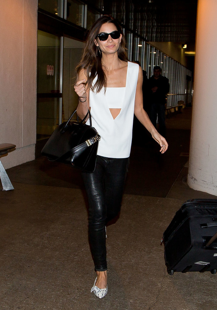 Lily Aldridge showed a bit of skin without being overtly sexy thanks to her white tank that flashed some skin right over her navel. She wore the bright piece with black skinnies, a leather carryall, and printed heels.