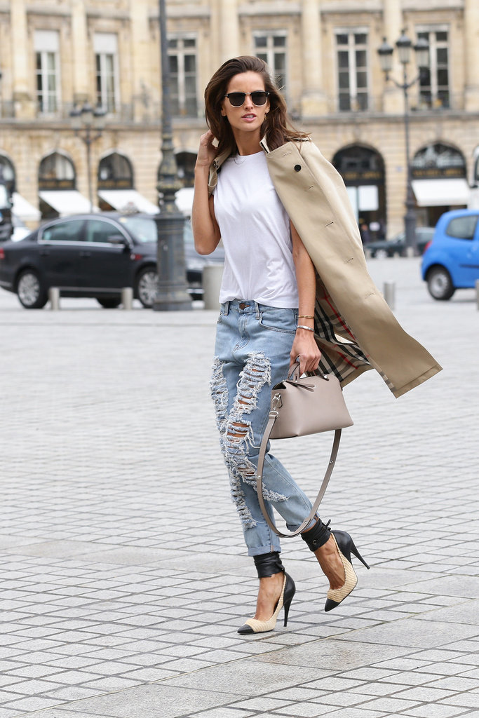 Izabel Goulart went for ultraripped jeans, wearing them with a classic white tee and trench. But no sneakers here! The model picked ankle-wrap stilettos.