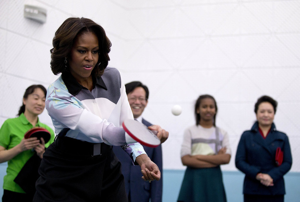 The first lady played some ping-pong while visiting a school that prepares students to study at universities abroad.