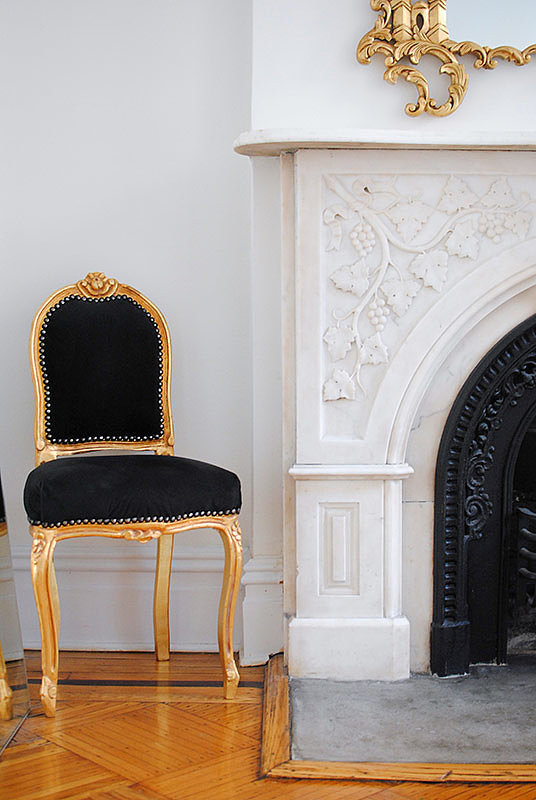 A black-and-gold chair occupies a corner to top off the look. Source: Homepolish