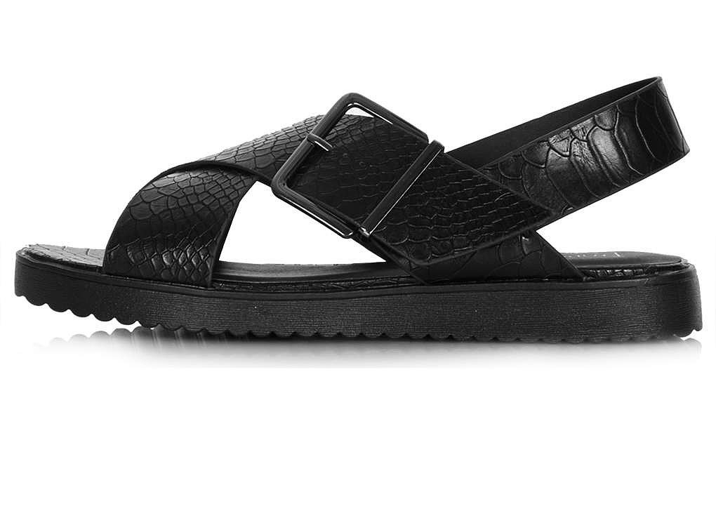 Topshop Hola black cross-buckle flat sandals ($40)