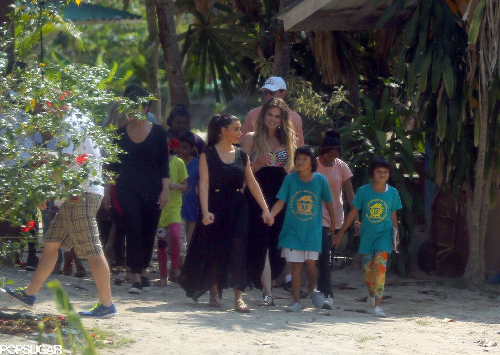Kim held hands with a child at an orphanage.
