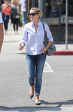 Reese Witherspoon in Navy Studded Valentino Flats and Goyard Tote