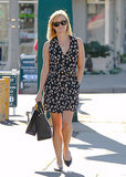 Reese Witherspoon in a Printed Wrap Dress and Studded Valentino Flats