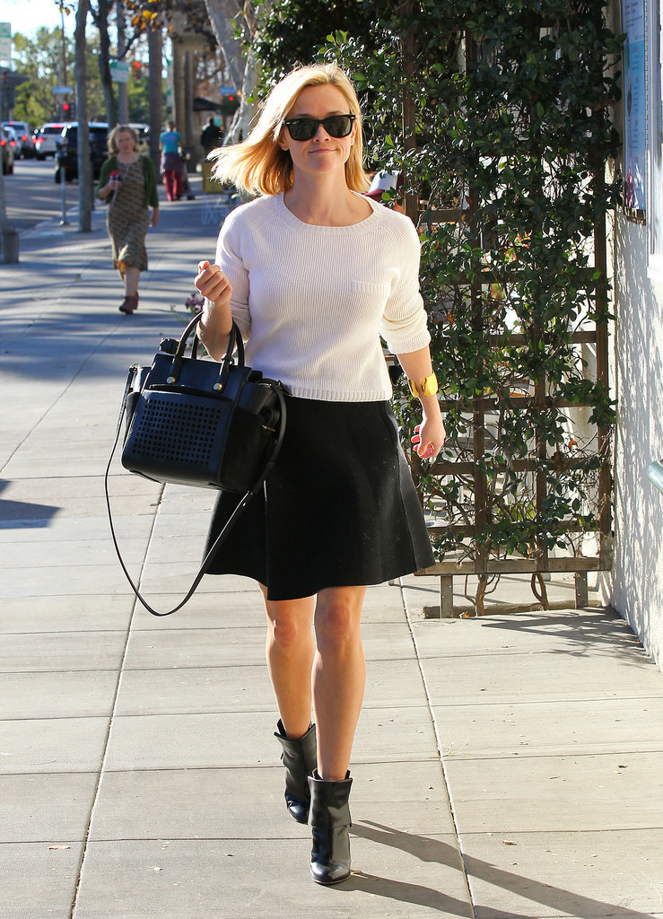 Reese Witherspoon in Black Skirt and Gianvito Rossi Booties